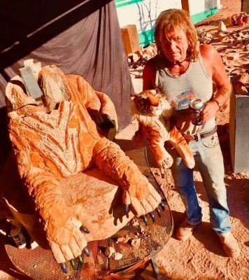 Cal and The Andamooka Tiger in the sculptor's open-air studio.