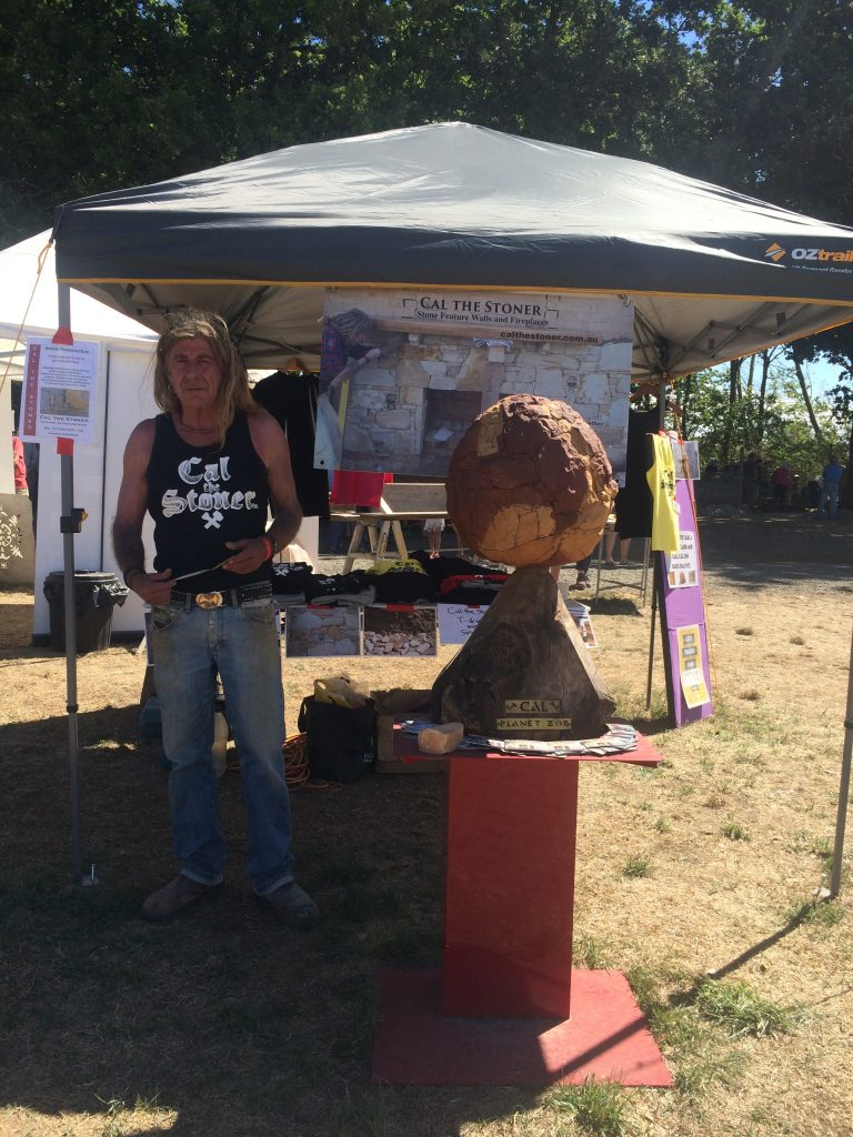 Cal standing beside Planet Zor of Galaxy Z at the Kyneton Lost Trades Fair