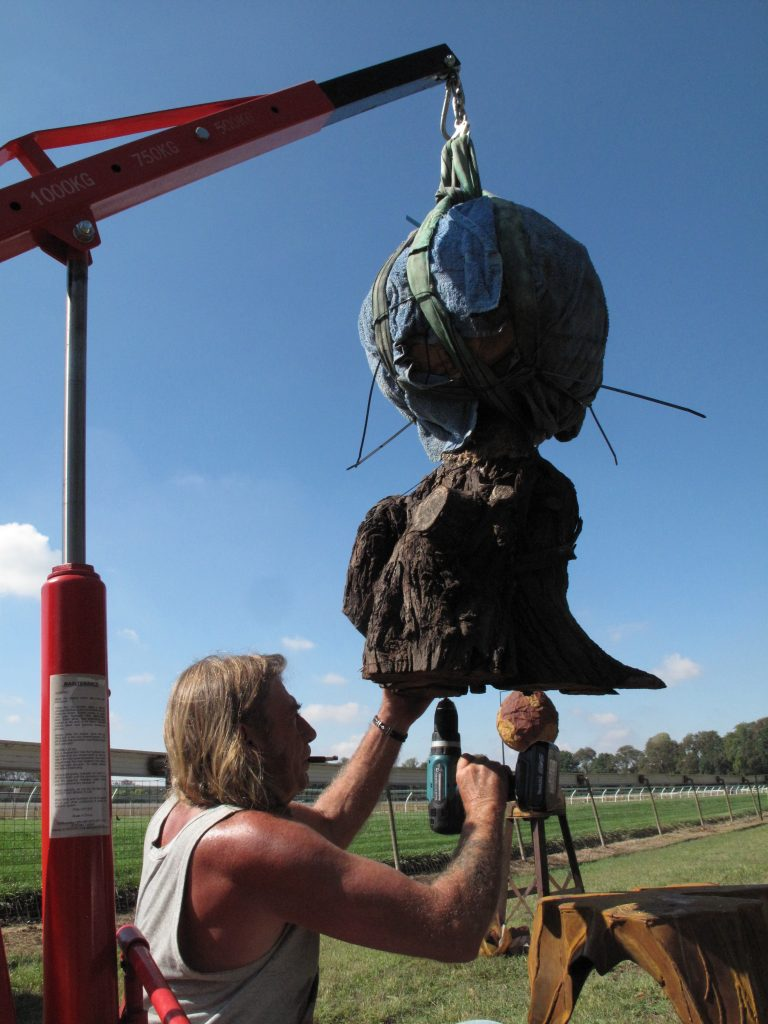 Installing solid stone sculptures requires skill, patience and equipment.