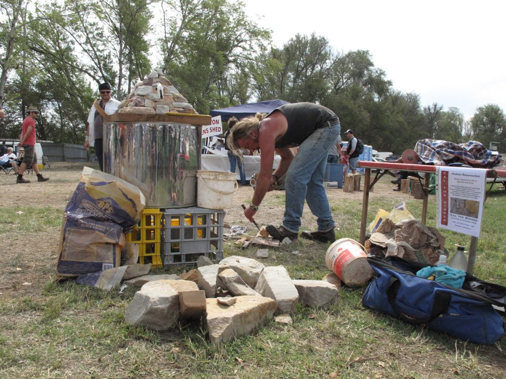 Cal the Stoner, sculptor in action at the Kyneton Lost Trades Fair.